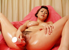 Yuki Aida pleasing her shave clam with a vibrating rod