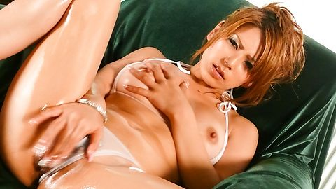 Sakura Kiryu oiled up and using a...