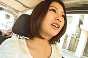 Cutie provides Asian blowjob while on the road  Photo 4