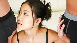 Japanese lingerie model sucking on two heads