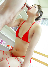 Toa Asian babe in red lingerie sucks cock and rubs it with feet
