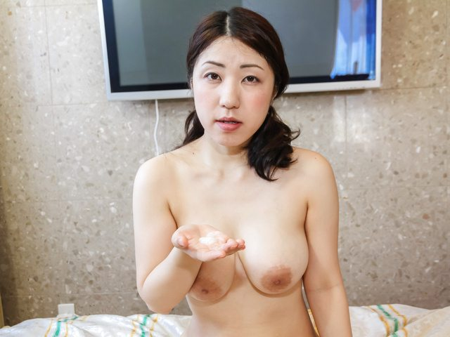 Nozomi runs her tongue up and down his dick for a japan blowjob Photo 2