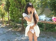 Japanese outdoor posing with young Yui Kasugano