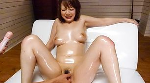 Hot milf enjoys rough stimulation on her hairy Asian pussy