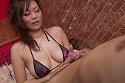 Busty asian milf Ren Mizumori gives head and a boob fuck Photo 2