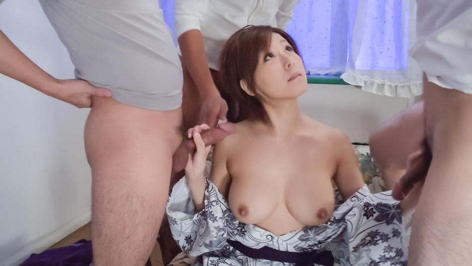 Japanese milf takes good care of two cocks