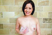 Asian milf plays with her pussy while in the tub Photo 4