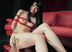 Nozomi Aiuchi rides a dildo in japanese bondage rope