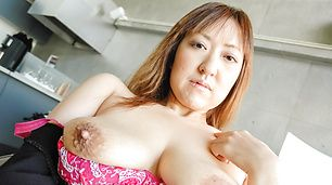 Mayumi with huge asian tits gets a cumshot on them