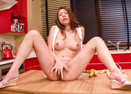 Miharu Kai Asian with big jugs fingers her pussy on kitchen table