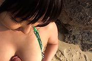 Horny asian milf Megumi Haruka sucks dick at the beach Photo 4