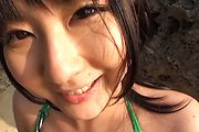 Horny asian milf Megumi Haruka sucks dick at the beach Photo 5