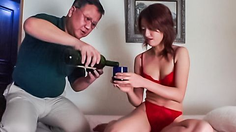 Japanese hottie in red lingerie humping a mature guy´s dick
