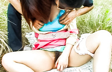 Nasty Asian couple fucking hardcore in a grassy field