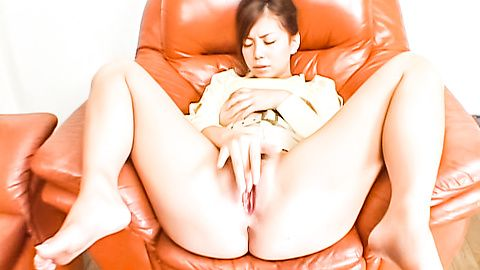Clit and boob playing busty Japanese lady on the couch