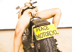 Sexy Japanese chick stripping and toy fucking on a motorcycle
